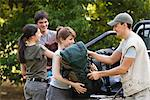 Young campers unloading backpacks from back of pick-up trucks Stock Photo - Premium Royalty-Free, Artist: Zoomstock, Code: 632-06317231