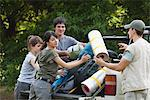 Young campers loading camping gear onto back of pick-up truck Stock Photo - Premium Royalty-Free, Artist: Mark Peter Drolet, Code: 632-06317272