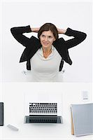 Businesswoman relaxing at desk, high angle view Stock Photo - Premium Royalty-Freenull, Code: 632-06317464