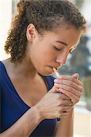 Young woman lighting cigarette Stock Photo - Premium Royalty-Freenull, Code: 632-06317603