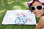 Girl with drawing on grass Stock Photo - Premium Royalty-Free, Artist: Uwe Umsttter, Code: 632-06317761