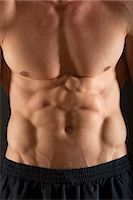 Barechested muscular man, mid section Stock Photo - Premium Royalty-Freenull, Code: 632-06317862