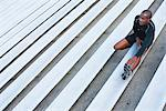 Man stretching on bleacher, high angle view Stock Photo - Premium Royalty-Free, Artist: Blend Images, Code: 632-06317995