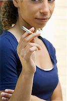 Young woman smoking cigarette Stock Photo - Premium Royalty-Freenull, Code: 632-06318014