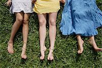 Cropped shot of legs of three teen girls lying on the grass Stock Photo - Premium Royalty-Freenull, Code: 618-06318470