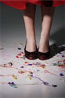 streamer - close up of woman wearing red shoes with confetti on the floor Stock Photo - Premium Royalty-Freenull, Code: 618-06318941