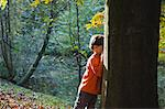 Boy playing hide-and-seek in woods Stock Photo - Premium Royalty-Free, Artist: GreatStock, Code: 633-06322506