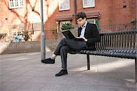 people sitting on bench - Young businessman using laptop while sitting on bench Stock Photo - Premium Royalty-Freenull, Code: 693-06324321