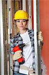 Portrait of beautiful mid adult contractor with drill Stock Photo - Premium Royalty-Free, Artist: Glowimages, Code: 693-06324460