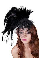 feather  close-up - Portrait of young brunette wearing feathered veil over white background Stock Photo - Premium Royalty-Freenull, Code: 693-06324535