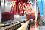 Vehicle moving on conveyor going through cleaning in car wash Stock Photo - Premium Royalty-Free, Artist: Blend Images, Code: 693-06324577