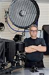 Portrait of a technician with arms crossed standing in photographer's studio Stock Photo - Premium Royalty-Free, Artist: Aflo Relax, Code: 693-06324871
