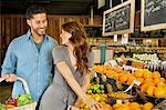 Beautiful young couple looking at each other while shopping in supermarket Stock Photo - Premium Royalty-Free, Artist: CulturaRM, Code: 693-06324913