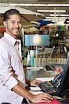 Portrait of a happy store clerk in shop Stock Photo - Premium Royalty-Free, Artist: Aflo Relax, Code: 693-06325057