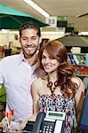 Portrait of a happy couple standing in store Stock Photo - Premium Royalty-Free, Artist: Miles Ertman, Code: 693-06325063