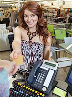 person on phone with credit card - Portrait of a happy young woman paying through credit card Stock Photo - Premium Royalty-Freenull, Code: 693-06325066