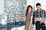 Young couple looking at color samples together in contemporary kitchen Stock Photo - Premium Royalty-Free, Artist: Cultura RM, Code: 693-06325099
