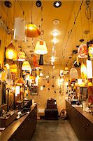Lighting equipments on display in lights store Stock Photo - Premium Royalty-Freenull, Code: 693-06325133