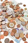 Close-up of paper currencies and coins Stock Photo - Premium Royalty-Freenull, Code: 693-06325204