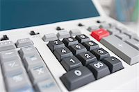 Close-up of calculator Stock Photo - Premium Royalty-Freenull, Code: 693-06325226
