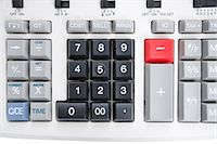 Close-up of pushbuttons of calculator Stock Photo - Premium Royalty-Freenull, Code: 693-06325229