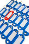 Close-up of red surrounded with blue key ring tags Stock Photo - Premium Royalty-Free, Artist: I Dream Stock, Code: 693-06325295