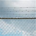 Chain Link Fence and Barbed Wire Stock Photo - Premium Royalty-Free, Artist: Andrew Kolb, Code: 600-06325427