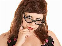 Cute woman with finger on chin over white Stock Photo - Royalty-Freenull, Code: 400-06328776