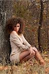 beautiful young woman sitting near a tree Stock Photo - Royalty-Free, Artist: artfotoss                     , Code: 400-06329701