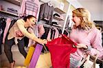 Image of two greedy girls fighting for red tanktop in department store Stock Photo - Royalty-Free, Artist: pressmaster                   , Code: 400-06332266