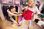 Image of two greedy girls fighting for red tanktop in department store Stock Photo - Royalty-Free, Artist: pressmaster                   , Code: 400-06332267