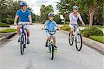 A young family of man and woman parents and one boy child, cycling together. Stock Photo - Royalty-Free, Artist: darrenbaker                   , Code: 400-06332971