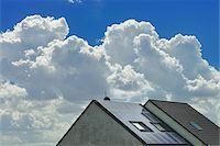 solar power - Solar Panels on House Rooftop, Hesse, Germany Stock Photo - Premium Royalty-Freenull, Code: 600-06334287