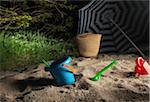 Toys and Sun Umbrella on Beach at Night Stock Photo - Premium Rights-Managed, Artist: oliv, Code: 700-06334354