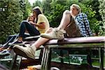 Three Friends Sitting on Roof of Car Stock Photo - Premium Rights-Managed, Artist: Ty Milford, Code: 700-06334616