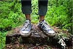 Close-Up of Woman Wearing Sneakers Standing on Tree Stump Stock Photo - Premium Rights-Managed, Artist: Ty Milford, Code: 700-06334627