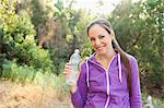 Woman holding water bottle Stock Photo - Premium Royalty-Freenull, Code: 621-06334797