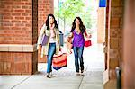 Two girlfriends shopping together and having fun. Stock Photo - Premium Royalty-Freenull, Code: 6106-06334839