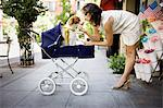 Dog sitting in a pram bring kissed by woman Stock Photo - Premium Royalty-Freenull, Code: 6106-06335175