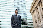 Businessman looking into distance in financial district Stock Photo - Premium Royalty-Free, Artist: Allan Baxter, Code: 614-06336146