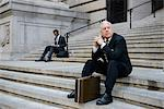 Businessmen sitting on building steps Stock Photo - Premium Royalty-Free, Artist: Cultura RM, Code: 614-06336149