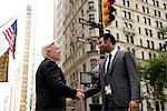 Businessmen shaking hands on Wall Street, New York City Stock Photo - Premium Royalty-Free, Artist: Blend Images, Code: 614-06336182