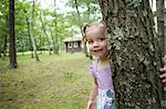 Girl hiding behind tree Stock Photo - Premium Royalty-Free, Artist: CulturaRM, Code: 614-06336281