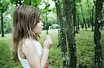 Girl blowing bubbles in forest Stock Photo - Premium Royalty-Free, Artist: CulturaRM, Code: 614-06336304