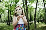Girl blowing bubbles in forest Stock Photo - Premium Royalty-Free, Artist: CulturaRM, Code: 614-06336306