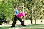 Yoga instructor and student in park Stock Photo - Premium Royalty-Free, Artist: Cultura RM, Code: 614-06336326