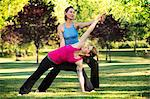Yoga instructor and student in park Stock Photo - Premium Royalty-Free, Artist: Cultura RM, Code: 614-06336332