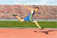 finish line - Runner crossing the finish line Stock Photo - Premium Royalty-Freenull, Code: 614-06336365
