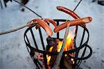 Sausages on sticks above fire Stock Photo - Premium Royalty-Free, Artist: Robert Harding Images, Code: 6102-06336720