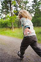 running away scared - Child running through forest Stock Photo - Premium Royalty-Freenull, Code: 6102-06336727
